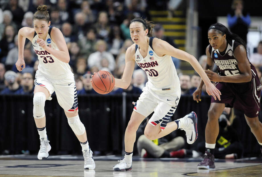 Connecticut's Katie Lou Samuelson, left, and Breanna Stewart, center, start a fast break in front of Mississippi State's Chinwe Okorie during the first half of an NCAA college basketball game in the regional semifinals of the women's NCAA Tournament, Saturday, March 26, 2016, in Bridgeport, Conn. (AP Photo/Jessica Hill)