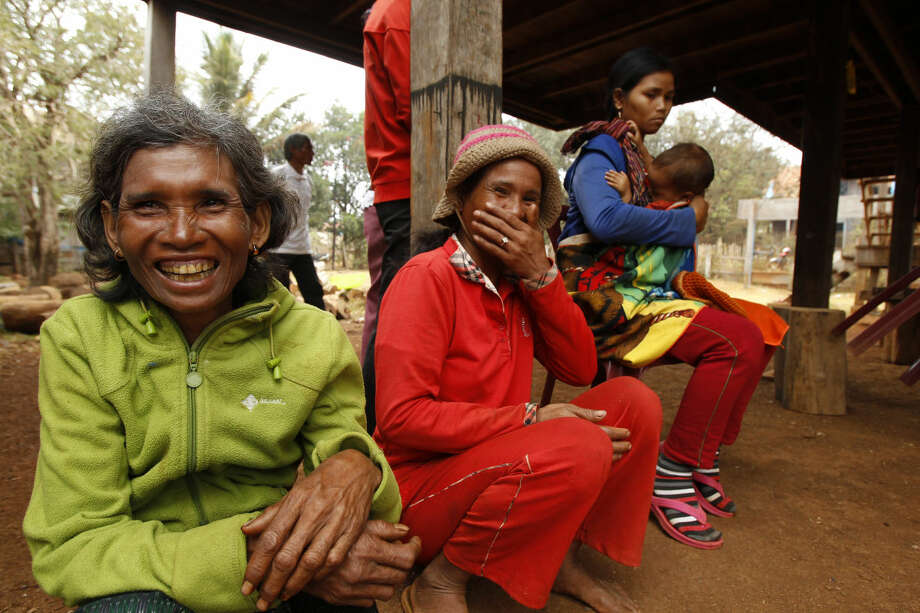 In this Feb. 26, 2015 photo, indigenous Bunong residents of Bousra commune gather in Mondulkiri province, in eastern Cambodia. The Cambodian human rights group LICADHO estimates that more than 200 concessions and other state-linked land deals have harmed half a million people in the country. The U.N. has called land conflicts, including those created by the long-term leases, the country's No. 1 human rights problem. (AP Photo/Heng Sinith)