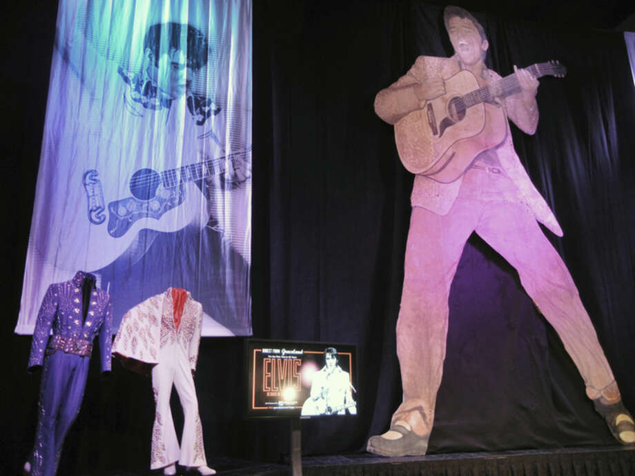 This Wednesday, Feb. 25, 2015 photo shows simple and bedazzled suits once worn by Elvis, many while performing on-stage in Las Vegas displayed at the Westgate Las Vegas Hotel, originally the International Hotel in Las Vegas, Nev. The costumes are expected to be among the memorabilia straight from his Graceland home in Memphis, Tenn. It's part of a partnership between Graceland and the Westgate Las Vegas to establish a permanent exhibit and revive the Elvis concert experience in the showroom where the icon once performed. (AP Photo/ Kimberly Pierceall)