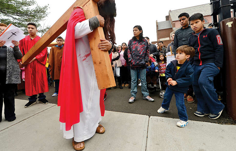 Hour photo / Erik Trautmann Darwin Aplacano portrays Jesus as nearly 100 parishioners of St. Joseph Church observe the Living Stations of the Cross at the church in South Norwalk on Good Friday.