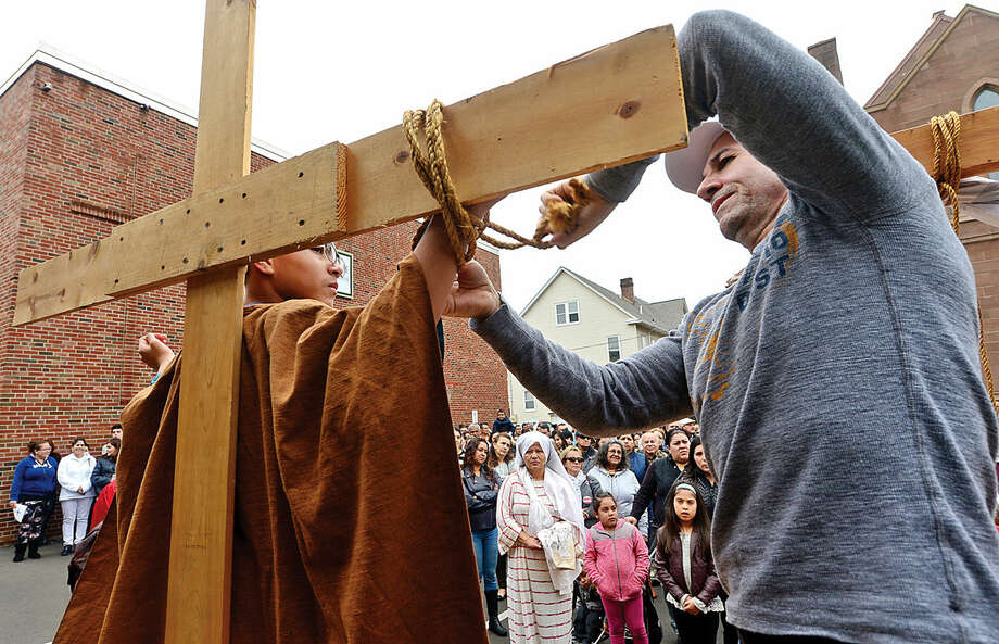 Hour photo / Erik Trautmann Nearly 100 parishioners of St. Joseph Church observe the Living Stations of the Cross at the church in South Norwalk on Good Friday.