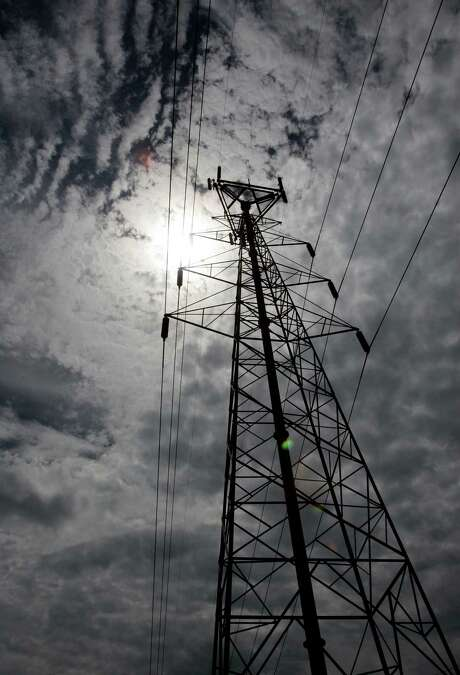 Electricity rates have risen higher in competitive markets throughout Texas than they have in some markets where the electric utility remains regulated. (AP file photo) Photo: Tony Gutierrez, STF / AP2007