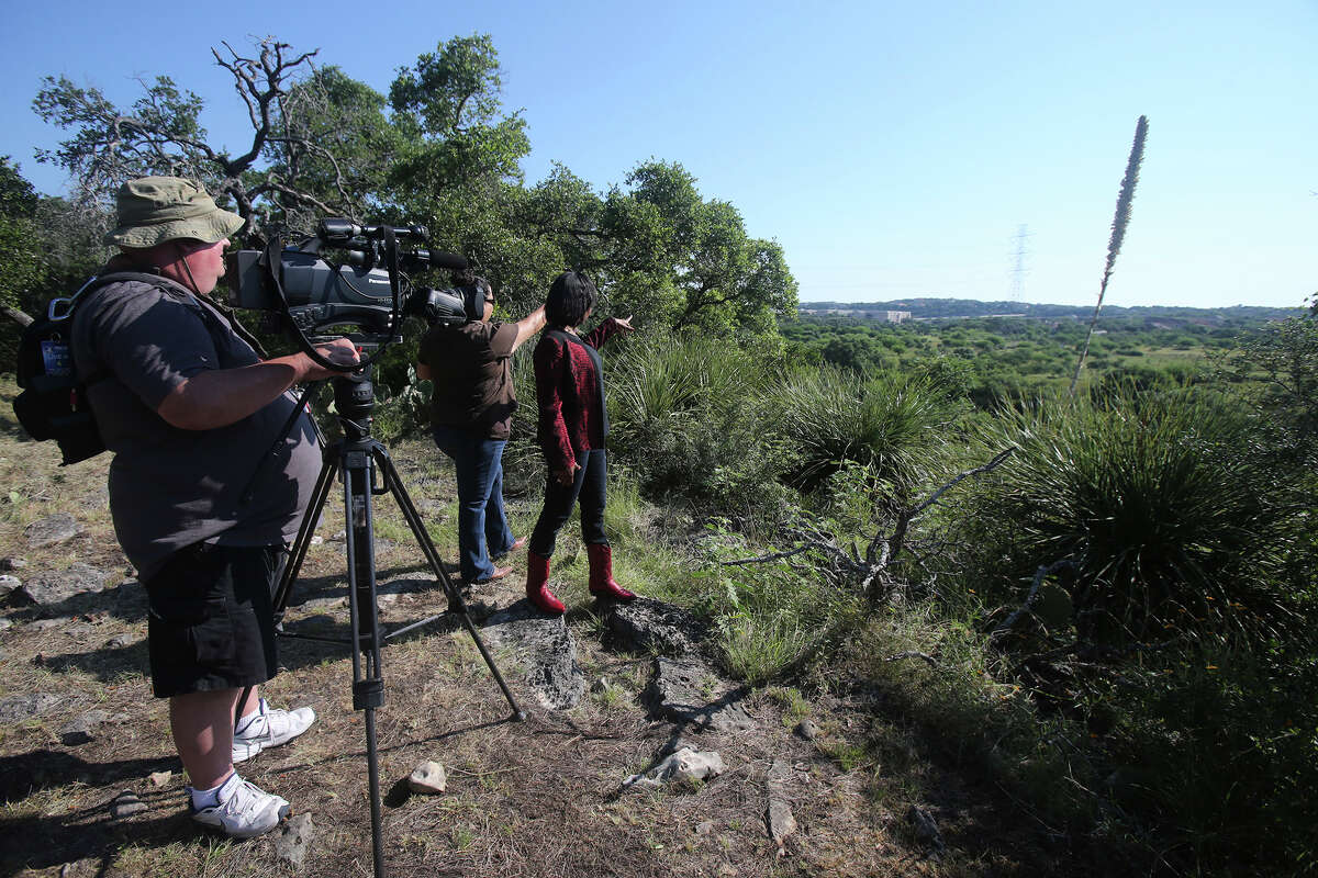 San Antonio mayor Ivy Taylor (center, facing away) pauses Tuesday June 7, 2016 in an area that will become a new park in San Antonio in the north central area of the city. The Classen-Steubing family has agreed to sell 204 acres of their ranch to the City of San Antonio. This is one of the last major, undeveloped parcels of land on the North Side and is over the sensitive Edwards Aquifer recharge Zone.