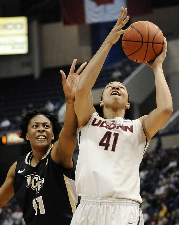Connecticut's Kiah Stokes shoots as Central Florida's Yanique Gordon, left, defends during the first half of an NCAA college basketball game, Wednesday, Feb. 19, 2014, in Hartford, Conn. (AP Photo/Jessica Hill)