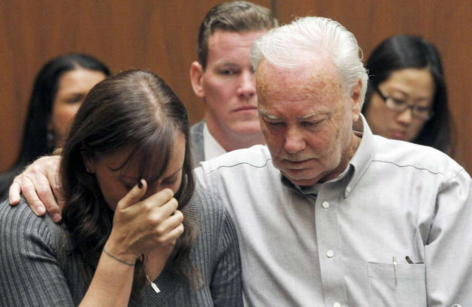 Evin Collins, and David Stow, sister and father of beating victim Bryan Stow are shown during a hearing Thursday Feb. 20, 2014 in Los Angeles. Two men, Marvin Norwood, and Louie Sanchez pleaded guilty Thursday to a 2011 beating at Dodger Stadium that left San Francisco Giants fan Stow brain damaged and disabled. The pair were immediately sentenced by an angry judge who called them cowards and the sort of people that sports fans fear when they go to games.(AP Photo/Nick Ut )