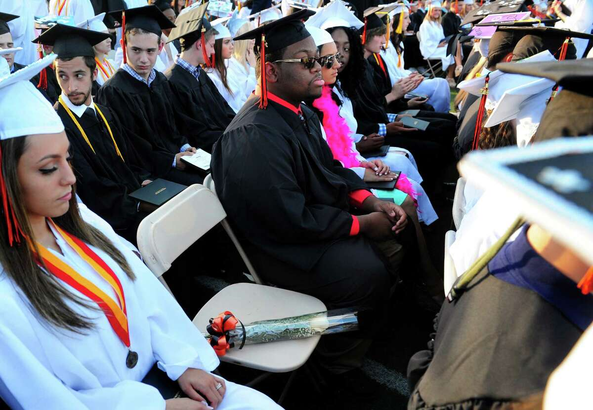 A single rose sits in an empty chair for student Eddy Conklin during Shelton High School's Class of 2016 Commencement Exercises in Shelton, Conn., on Friday June 10, 2016. Conklin was awarded his diploma postumously after being killed in a car accident in February.