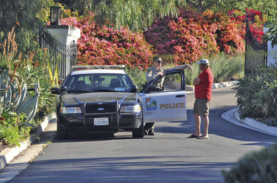 A Goleta Police officer stands guard near a home on Greenhill Way in unincorporated county territory between Santa Barbara and Goleta, Calif., on Thursday, March 24, 2016, as the Santa Barbara County Sheriff's Office opened a homicide investigation after deputies discovered the remains of three people in the house. Post-mortem examinations will be conducted to determine how the three died. (Rafael Maldonado/Santa Barbara News-Press via AP) SANTA MARIA TIMES OUT; SANTA BARBARA OUT; MANDATORY CREDIT