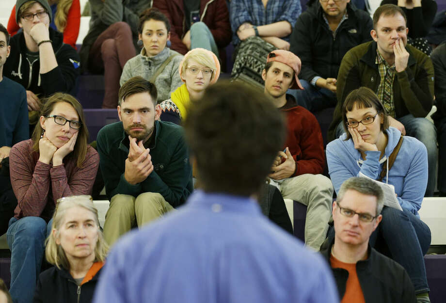 Attendees in a precinct group listen as a speaker voices support for Democratic presidential candidate Sen. Bernie Sanders, I-Vt., Saturday, March 26, 2016, during a Democratic caucus at Garfield High School in Seattle. Democrats caucused statewide in support of either Sanders or Hillary Clinton. (AP Photo/Ted S. Warren)