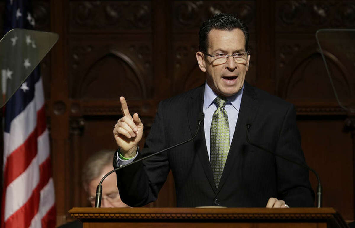 AP photo / Stephan Savoia Connecticut Gov. Dannel P. Malloy gestures as he emphasizes a point during his 2014 State of the State address in front of a joint session of the legislature in the House Chambers in Hartford Thursday.