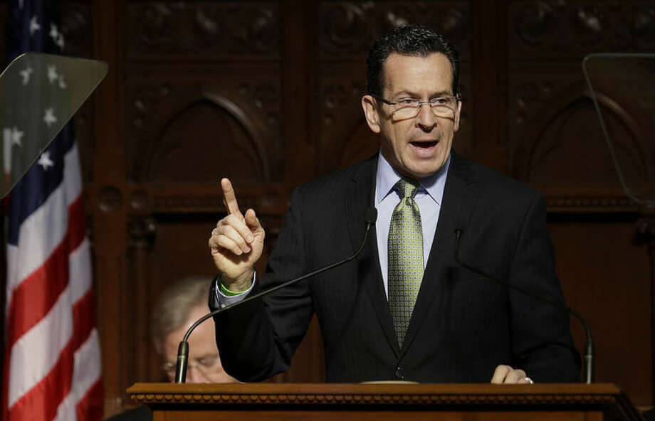 AP photo / Stephan SavoiaConnecticut Gov. Dannel P. Malloy gestures as he emphasizes a point during his 2014 State of the State address in front of a joint session of the legislature in the House Chambers in Hartford Thursday.