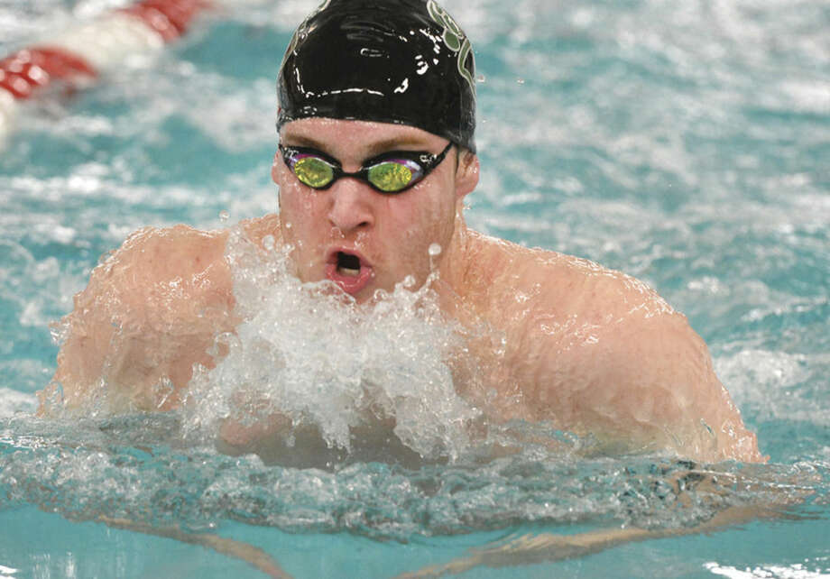 Hour Photo/Alex von Kleydorff Eddie Donovan swims the 200 Medley relay in FCIAC