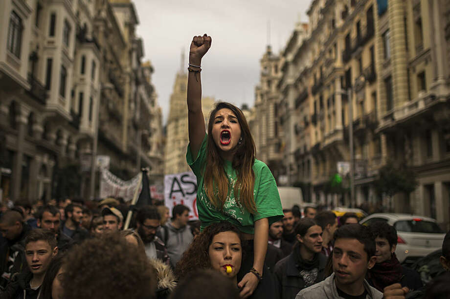 Students shout slogans as they march during the second day of a student's strike in Madrid, Spain Thursday Feb. 26, 2015. Students across Spain are protesting changes in the system of university degrees with protests and a two-day strike. (AP Photo/Andres Kudacki)