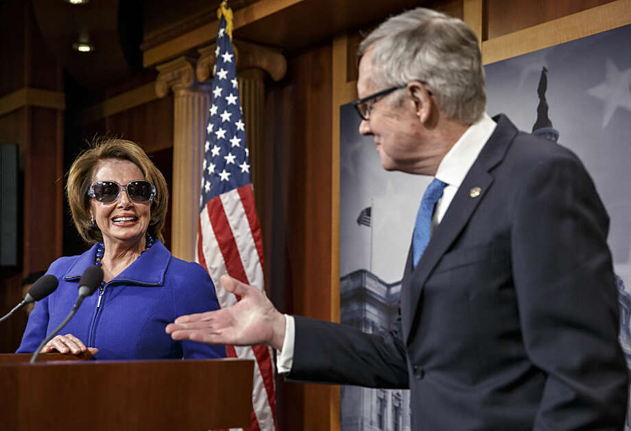 House Minority Leader Nancy Pelosi of Calif., left, gets chuckles when she started a news conference by donning dark glasses, a teasingly sympathetic gesture to Senate Minority Leader Harry Reid of Nev., right, as recovers from a serious injury to his right eye suffered while exercising at his Nevada home during the holidays, Thursday, Feb. 26, 2015, on Capitol Hill in Washington. Reid wore normal reading glasses Thursday, but with an opaque right lens to hide the injured eye. (AP Photo/J. Scott Applewhite)