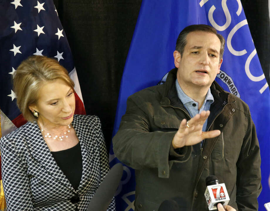 Republican presidential candidate, Sen. Ted Cruz-R-Texas, right, responds to the question had he ever cheated on his wife, as former Republican candidate Carly Fiorino listens a campaign stop Monday, March 28, 2016, in Rothschild, Wisc. (AP Photo/Charles Rex Arbogast)