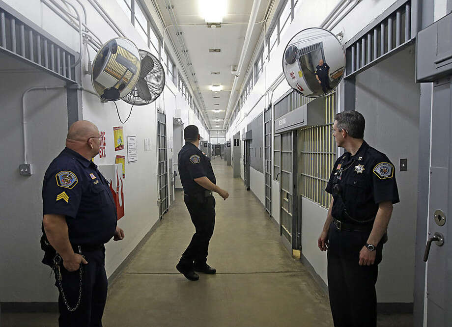 Department of Corrections Officers are shown in the Uinta 5 receiving and orientation unit during a media tour Thursday, Feb. 26, 2015, at the Utah State Correctional Facility in Draper, Utah. Gov. Gary Herbert said Thursday that he's opposed to the idea of allowing a state commission to pick a location to build a new prison instead of leaving the decision with the Legislature. (AP Photo/Rick Bowmer, Pool)