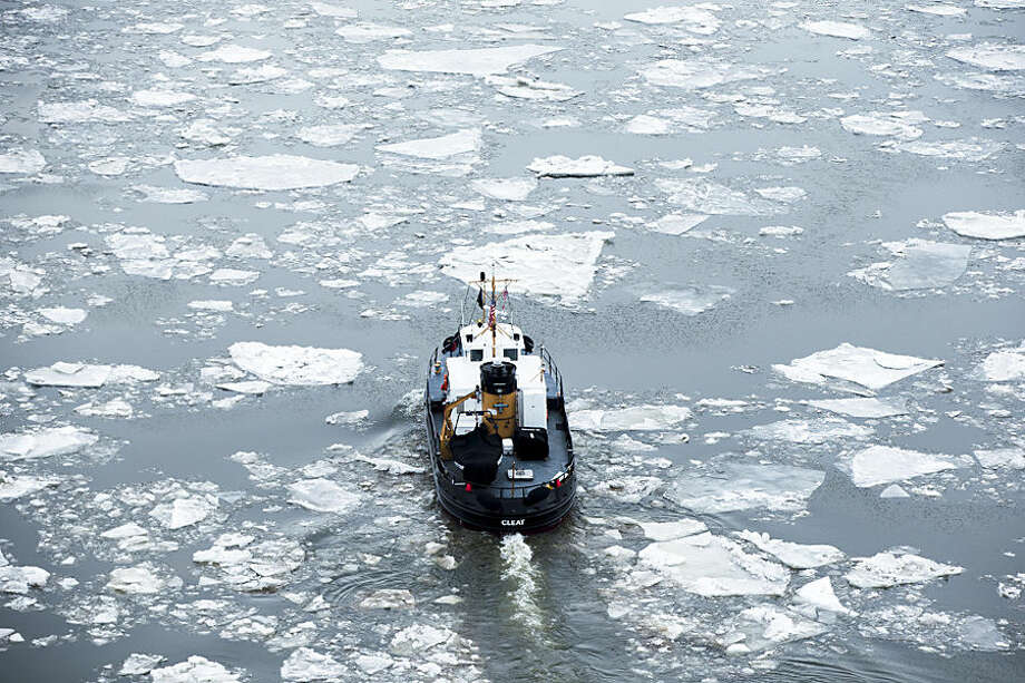 The U.S. Coast Guard Cutter Cleat operates in the Delaware River as part of its winter ice breaking mission, Thursday, Feb. 26, 2015, in Philadelphia. (AP Photo/Matt Rourke)