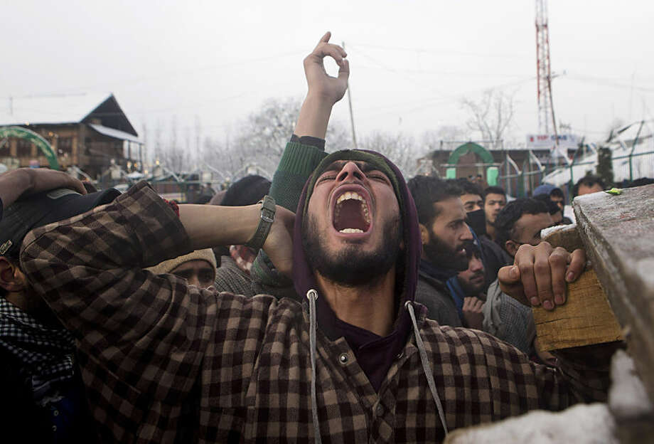 A Kashmiri Muslim villager shouts slogans during the funeral procession of Shabir Ahmed Gania, a suspected rebel in Drubgham, some 55 kilometers (33 miles) south of Srinagar, Indian controlled Kashmir, Thursday, Feb. 26, 2015. Thousands attended the funeral of two suspected rebels killed in a gunbattle with Indian security forces Wednesday in this the disputed Himalayan region. (AP Photo/Dar Yasin)
