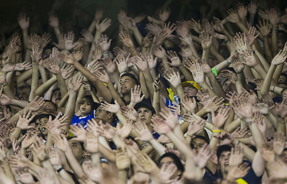 Argentina's Boca Juniors fans cheer their team during a Copa Libertadores soccer match against Uruguay`s Wanderers in Buenos Aires, Argentina, Thursday, Feb. 26, 2015. Boca Juniors won 2-1. (AP Photo/Rodrigo Abd)