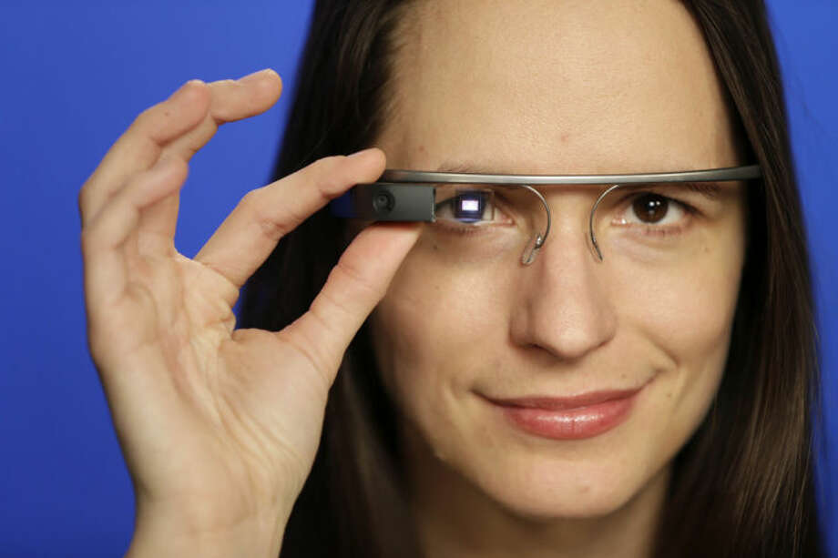Associated Press Technology Writer Barbara Ortutay wears Google Glass in New York, Friday, Feb. 21, 2014. (AP Photo/Seth Wenig)
