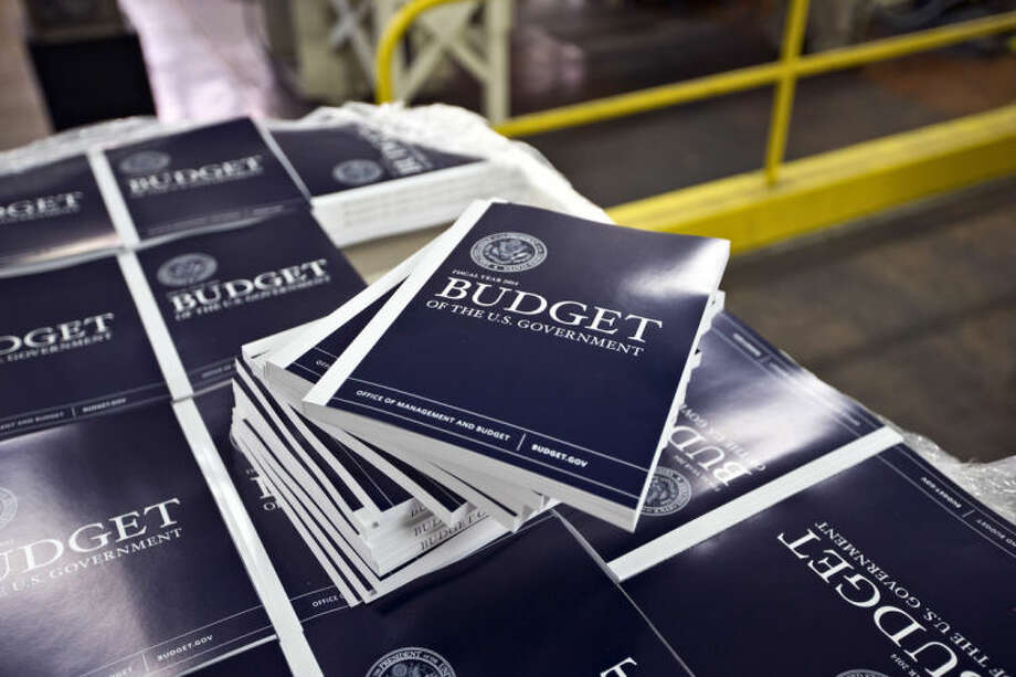 FILE - In this April 8, 2013, file photo, copies of President Barack Obama's budget plan for fiscal year 2014 are prepared for delivery at the U.S. Government Printing Office in Washington. Just four years ago, deficits and debt were an explosive political combination, propelling Republicans to control of the House and fueling the budget fights that would ensue over the next three years. Today, they are an afterthought _ a dying ember in Washington's political and policy landscape. (AP Photo/J. Scott Applewhite, File)