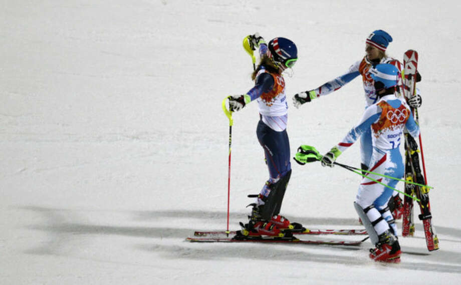 Women's slalom gold medalist, United States' Mikaela Shiffrin, left, is congratulated by Austria's Marlies Schild (silver), and Kathrin Zettel (bronze) at the Sochi 2014 Winter Olympics, Friday, Feb. 21, 2014, in Krasnaya Polyana, Russia.(AP Photo/Charles Krupa)