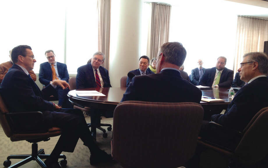 Gov. Dannel P. Malloy (far left) attends a roundtable discussion with city leaders on transportation issues affecting the state.