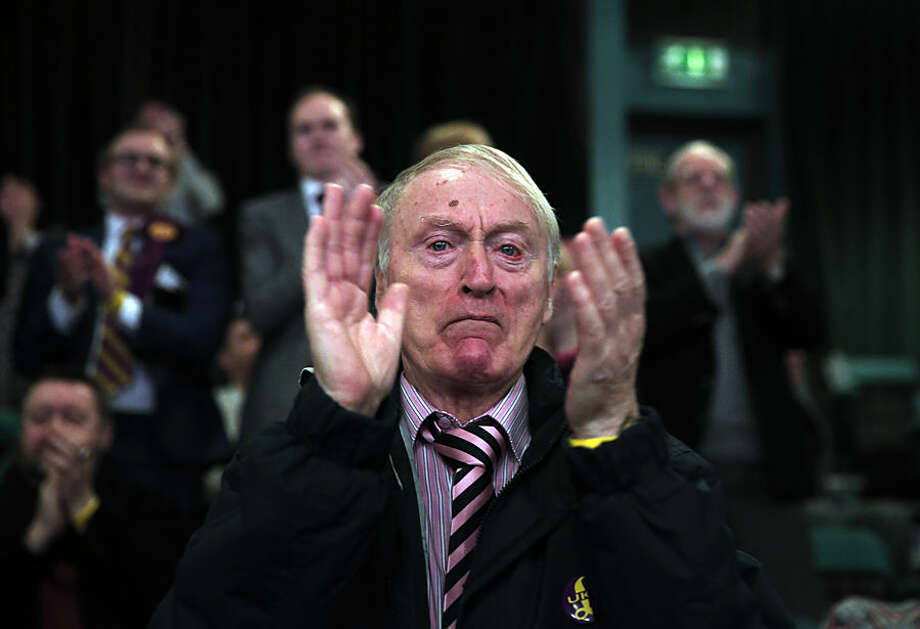 A supporter of the U.K. Independence Party (UKIP) applauds following a speech during the party's spring conference in Margate, England, Friday, Feb. 27, 2015. UKIP, led by Nigel Farage, which wants to curb immigration and pull Britain out of the European Union, has attracted growing numbers of voters as an alternative to Britain's mainstream parties. Britain will hold a general election on May 7, 2015. (AP Photo/Lefteris Pitarakis)