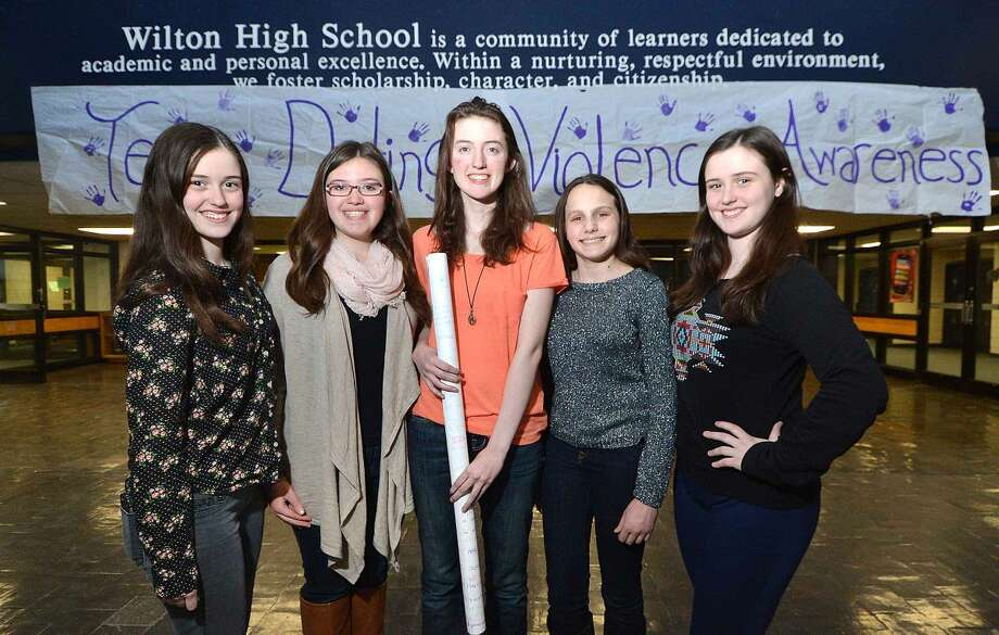 Lizzie MacDonald, Kaitlin Zappaterrini, Kaitlin McNamara, Nickia Muraskin and Haley MacDonald form The Teen PeaceWorks Club at Wilton High School.