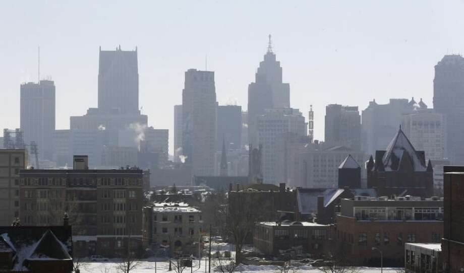 ADVANCE FOR USE SUNDAY, FEB. 23, 2014 AND THEREAFTER - This Feb. 12, 2014 photo shows the Detroit skyline from the city's midtown. (AP Photo/Carlos Osorio)