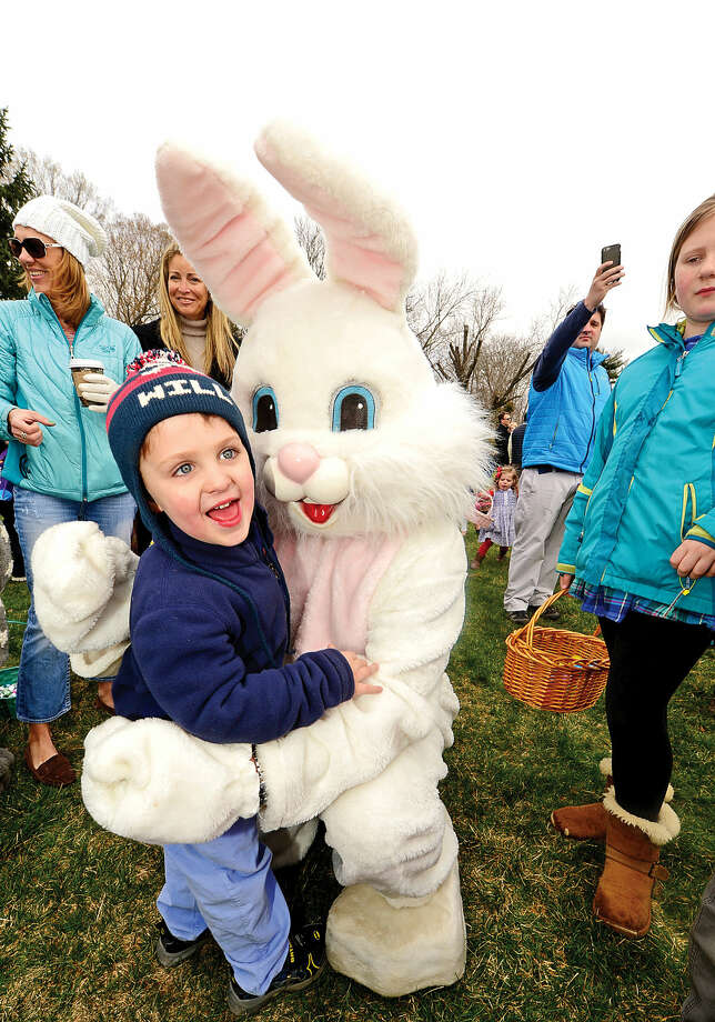 Hour photo / Erik Trautmann 3 year old Will Lenich greets the Easter Bunny during the Rowayton Civic Association annual Easter Egg Hunt Saturday at the Rowayton Community Center.