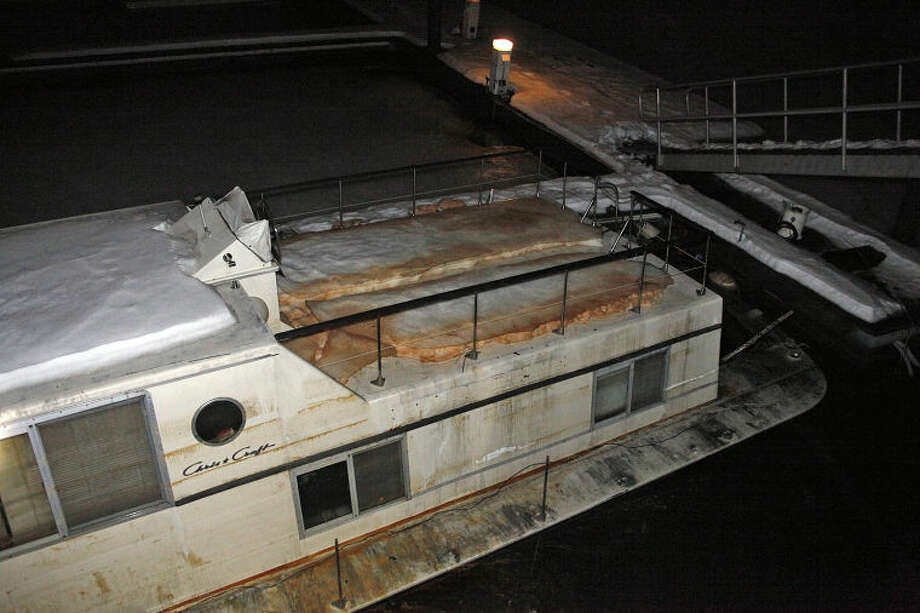 The scene of a sinking boat at Oyster Bend Marina in Norwalk Friday evening. Hour Photo / Danielle Calloway