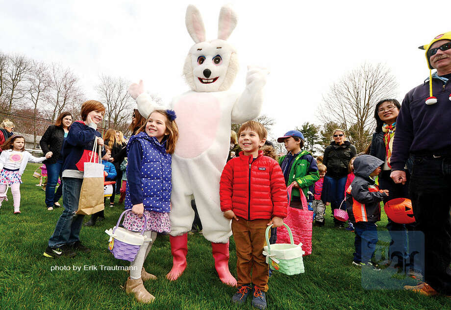 Hour photo / Erik Trautmann Emily Shiel, 6, and her brother Luke Shiel, 4, pose with the Easter Bunny during The Greens Farms Volunteer Fire Company 65th annual Easter Egg Hunt Saturday at Long Lots Elementary School in Westport