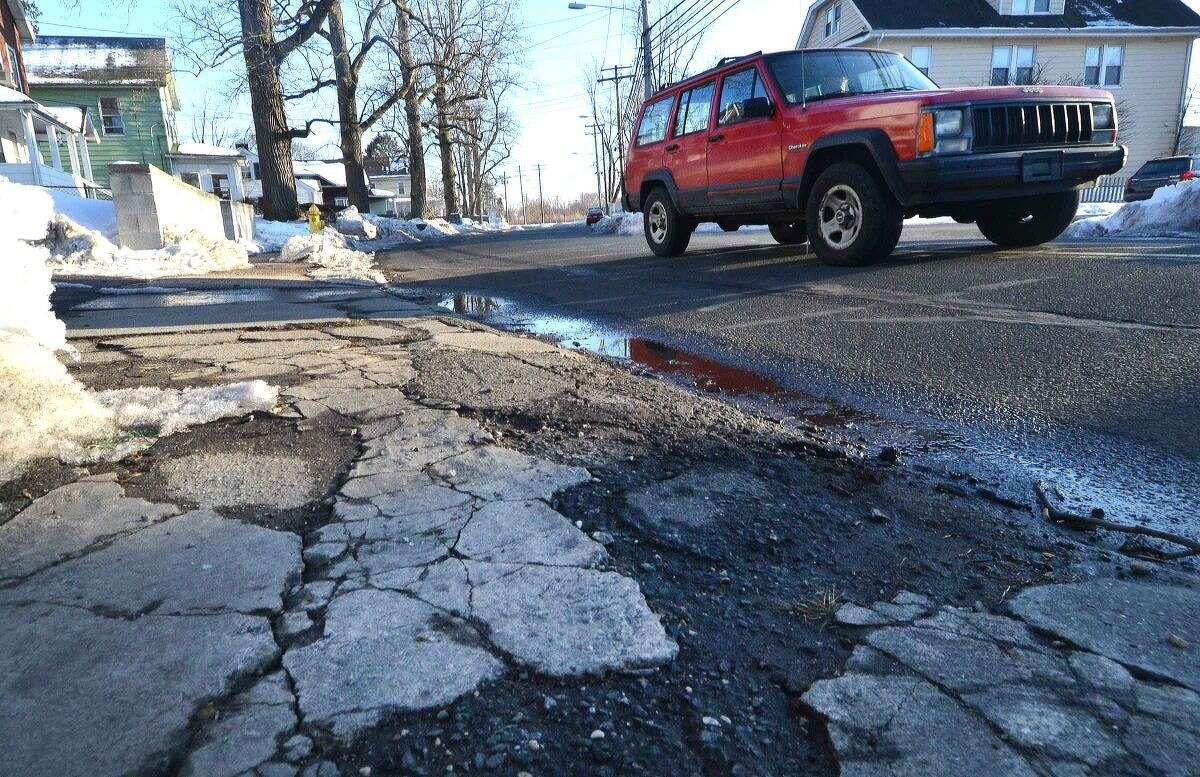 Hour Photo/Alex von Kleydorff Crumbling sidewalk in Norwalk