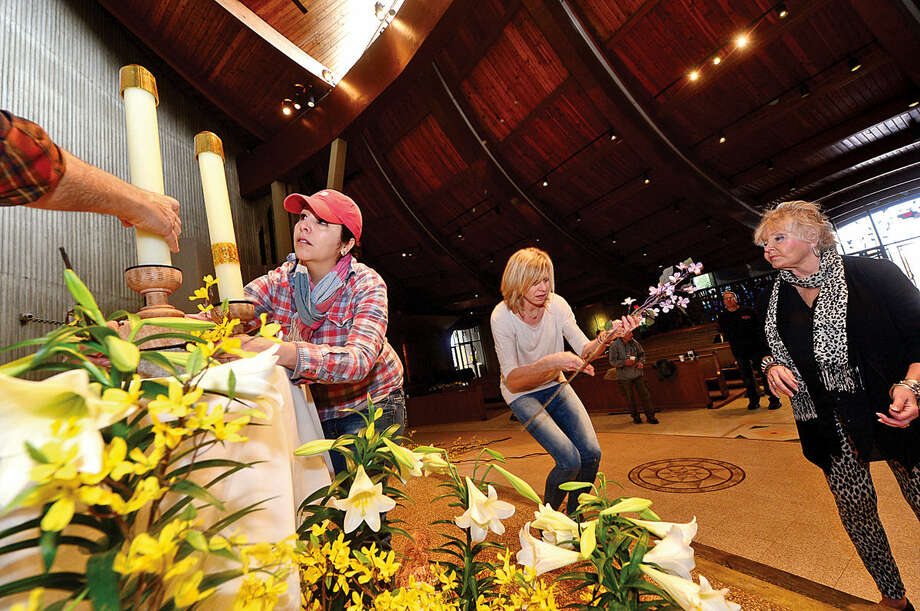 Hour photo / Erik Trautmann Members of the St. Philip Artist Guild including co-chair Dollka Morico, Melissa Chieffalo and Gayle Geckler decorate the St. Philip Church for Easter.