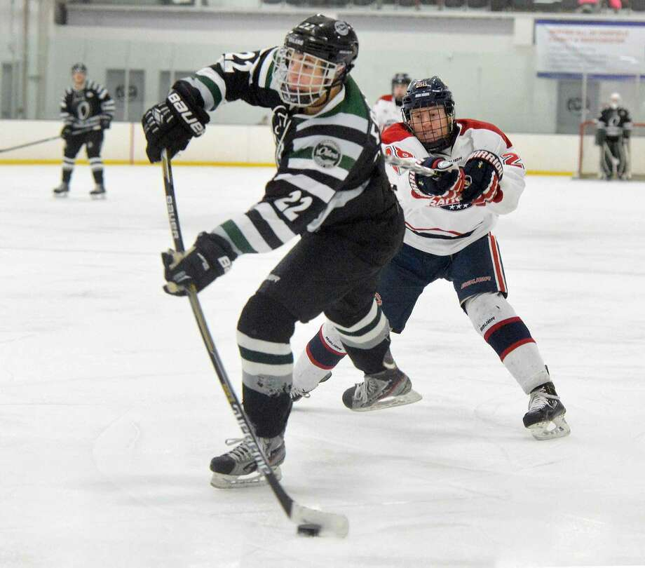 Hour Photo/Alex von Kleydorff CT Oilers #22 Sebastian Foster shoots and scores vs the Boston Junior Rangers