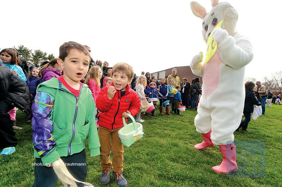 Hour photo / Erik Trautmann Ryan Heiser and Luke Shiel, both 4, get ready to collect candy and eggs during The Greens Farms Volunteer Fire Company 65th annual Easter Egg Hunt Saturday at Long Lots Elementary School in Westport