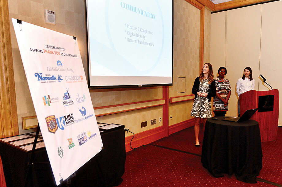 Hour photo / Erik Trautmann Francesca Forlivio, Account Executive at John M. Glover Agency, Vernece Richardson, Administrative Assistant at King Industries and Jacqueline Kaufman, Partner at Carmody, Torrence, Sandak and Hennessey, present their project report on the Careers on Fleek event during The Greater Norwalk Chamber of Commerce Norwalk Leadership Institute Graduation Breakfast Saturday at Dolce Norwalk.