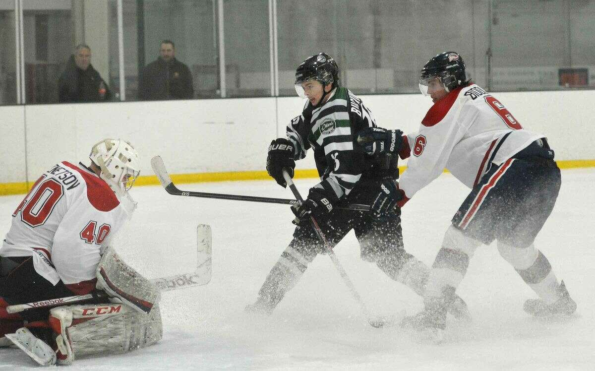 CT Oilers' Jim Buckingham shoots and scores one of his two goals in the Oilers' 6-3 win over the Boston Junior Rangers on Friday.(Hour photo/Alex von Kleydorff)