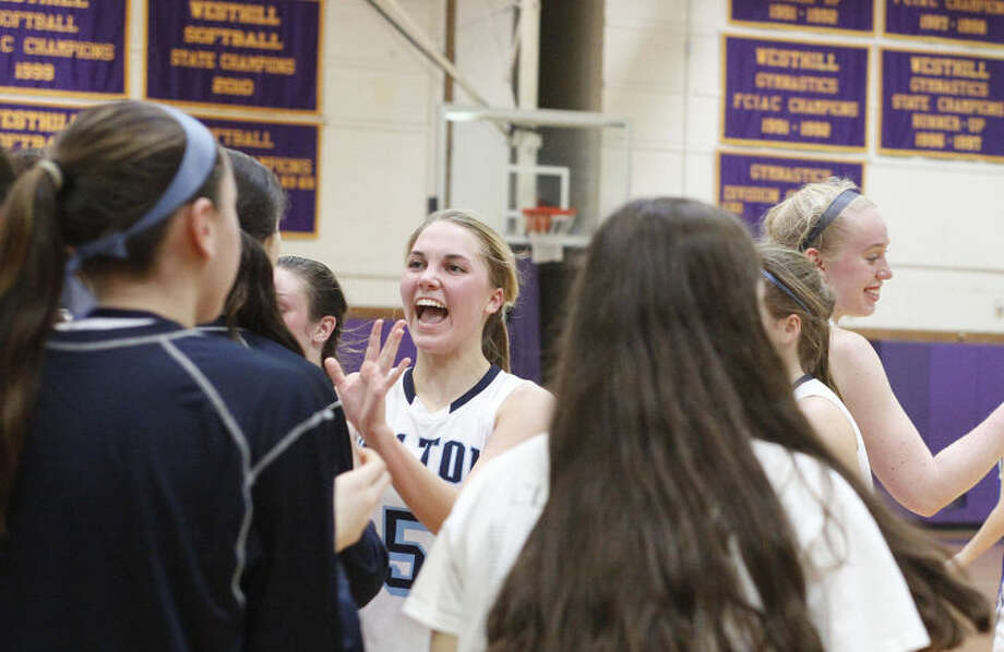 Wilton's #5, Karen Brosko, congratulates her teammates after winning a game against Ludlowe at West Hill High School Saturday afternoon. Hour Photo / Danielle Calloway