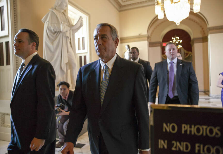 Speaker of the House John Boehner, R-Ohio, walks to the chamber as the House failed to advance a short-term funding measure to keep the Department of Homeland Security funded past a midnight deadline, at the Capitol in Washington, Friday evening, Feb. 27, 2015. Conservatives in Speaker Boehner's own party fought against three-week funding measure because it would not overturn Obama's actions on immigration. (AP Photo/J. Scott Applewhite)