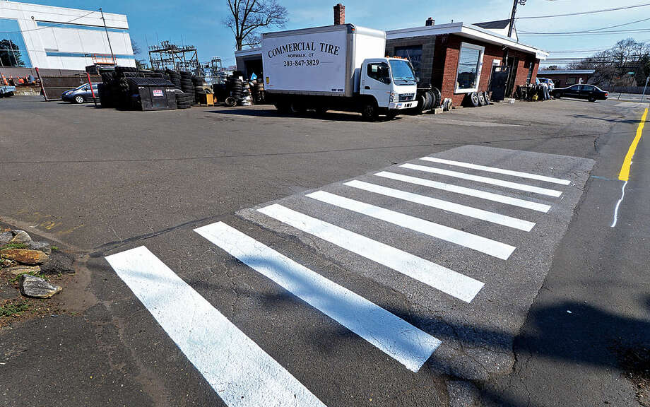 Hour photo / Erik Trautmann A new crosswalk was painted at the entrance of a driveway on Brookfield St in Norwalk after vehicles from Commercial Tire were repeatedly blocking the drive.