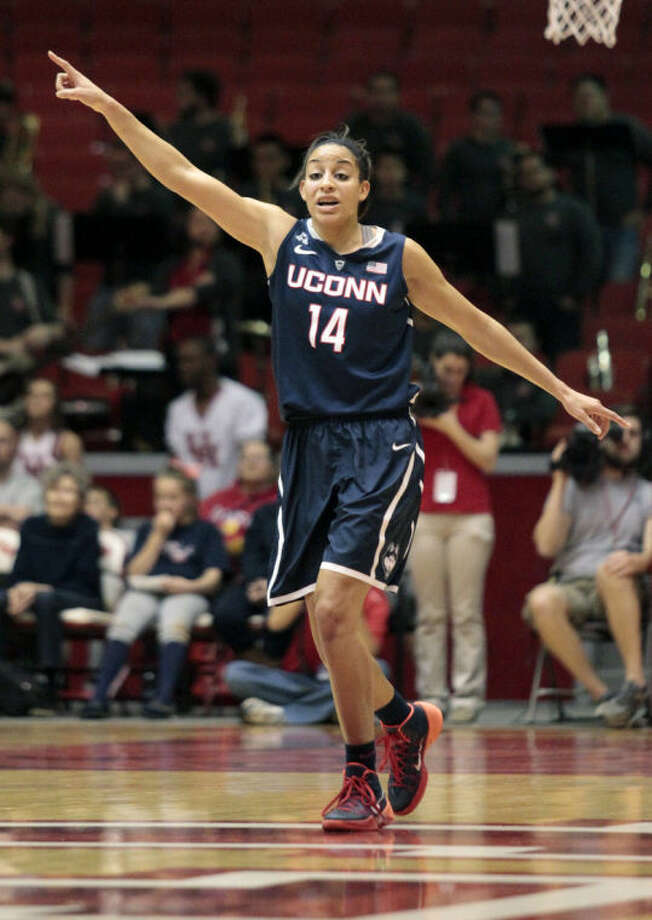 Connecticut guard Bria Hartley (14) calls out plays after scoring a basket during the first half of an NCCA women's basketball game against Houston, Saturday, Feb. 22, 2014, in Houston. (AP Photo/Patric Schneider)