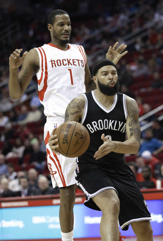 Houston Rockets' Trevor Ariza (1) backs off from Brooklyn Nets' Deron Williams during the first half of an NBA basketball game Friday, Feb. 27, 2015, in Houston. (AP Photo/Pat Sullivan)