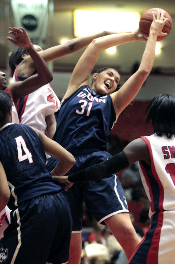 Connecticut center Stefanie Dolson (31) brings down a rebound during the first half of an NCCA women's basketball game against Houston, Saturday, Feb. 22, 2014, in Houston. (AP Photo/Patric Schneider)