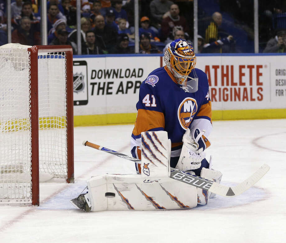 New York Islanders goalie Jaroslav Halak blocks a shot during the first period of the NHL hockey game against the Calgary Flames, Friday, Feb. 27, 2015, in Uniondale, N.Y. (AP Photo/Seth Wenig)