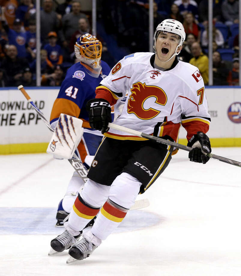 Calgary Flames' Michael Ferland, right, reacts after his penalty shot was blocked by New York Islanders goalie Jaroslav Halak during the first period of the NHL hockey game, Friday, Feb. 27, 2015, in Uniondale, N.Y. (AP Photo/Seth Wenig)