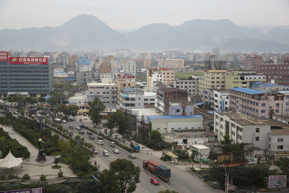 In this Tuesday, Oct. 20, 2015, photo, a view of Wenzhou, China. Wenzhou, a gritty enclave on China's eastern coast, is emerging as a significant transit point in global money-laundering networks. (AP Photo/Ng Han Guan)