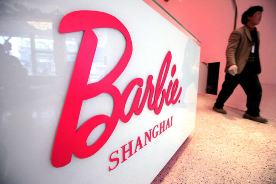 "FILE - In this March 6, 2009 file photo, a worker walks in the ""House of Barbie"" in Shanghai, China. In 2009, Mattel opened the flagship Barbie store but closed it after just two years. (AP Photo/Eugene Hoshiko, File)"