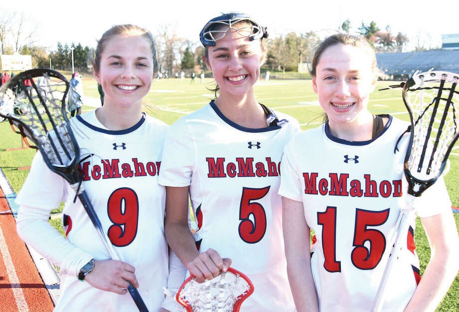 Hour photo/John Nash - Brien McMahon girls lacrosse captains are, from left, junior Bella Bean, and seniors Isabelle Greco and Brooke Lowe.
