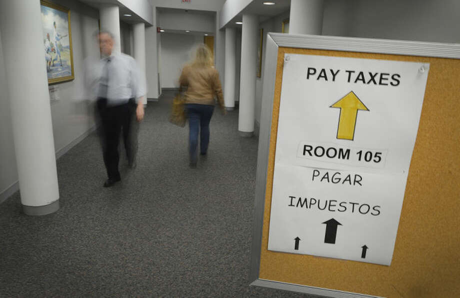 Hour Photo/Alex von Kleydorff A sign directs people to the Tax Collectors office in Norwalk City Hall on Monday, the last day to pay property taxes without penalties